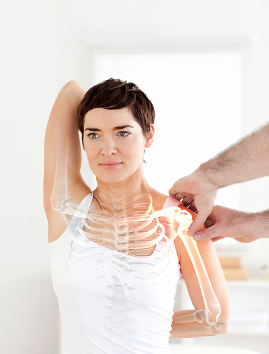Highlighted bones of woman recieving Osteopathic treatment